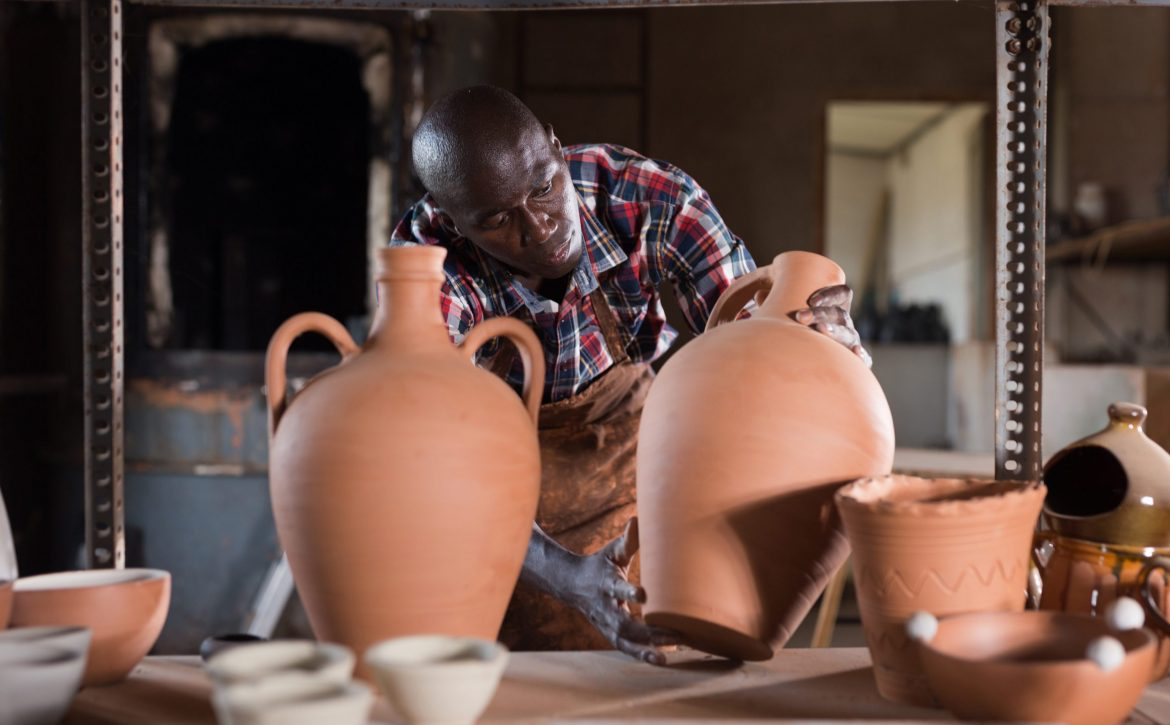 Potter checking clay products